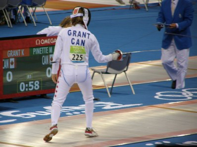 """Grant brandished a sword in the pentathlon's fencing portion before placing 31st. Afterward she blasted any boycotting of the games. """"The athletes have worked so hard to compete,"""" she said. """"Let them have their glory."""""""